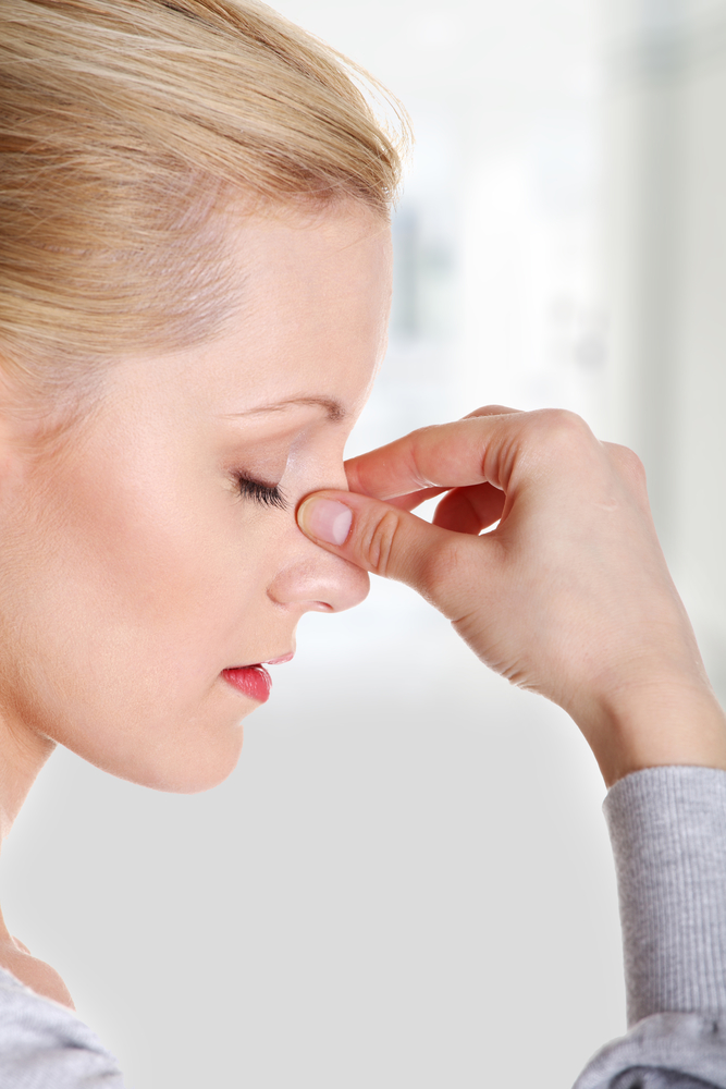 woman with sinus headache from allergies