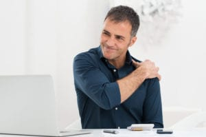 Businessman Suffering From RoanokeShoulder Pain