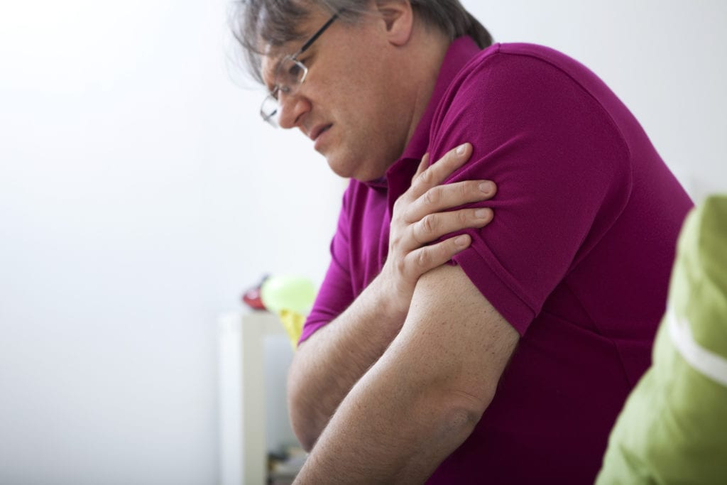 man experiencing arm pain