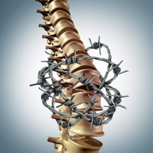 chronic pain in back depicted with spine and barbed wire