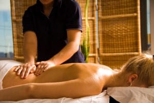 woman receiving massage therapy for muscle pain