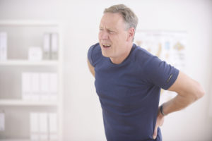 man suffering from spinal disc pain